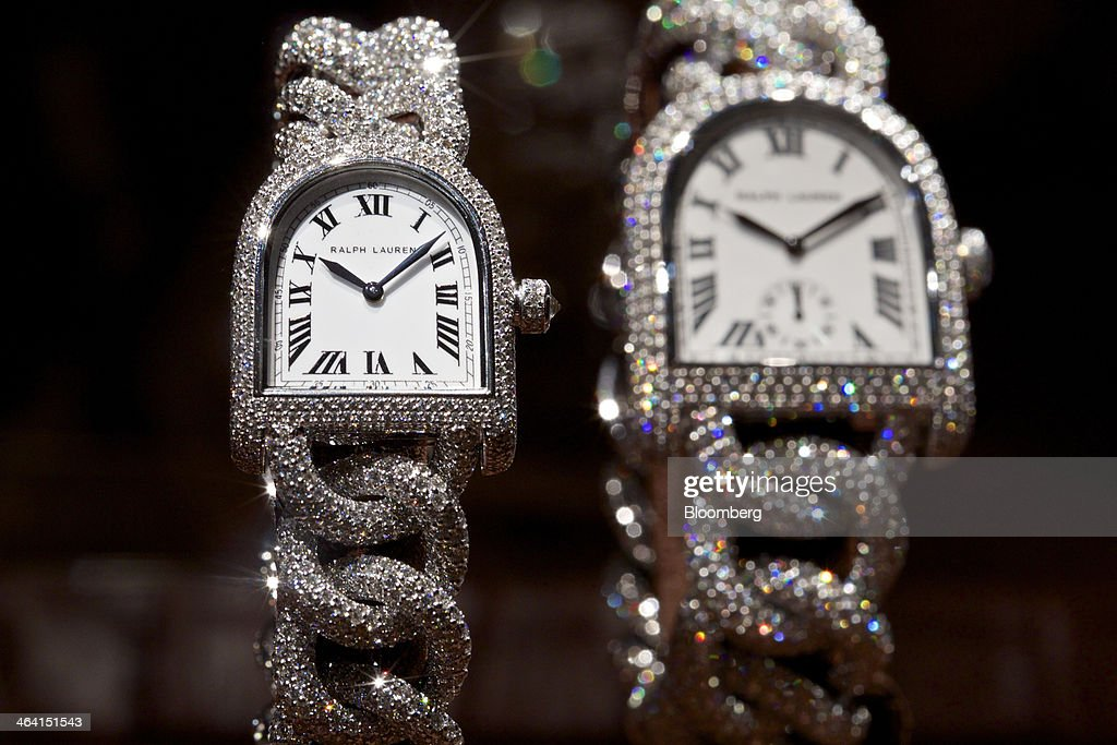 Jewels cover Stirrup Diamond Petit Link wristwatches, manufactured by Ralph Lauren, a part-owned unit of Cie. Financiere Richemont SA, as they sit on display at the Salon International de la Haute Horlogerie (SIHH) watch fair in Geneva, Switzerland, on Monday, Jan. 20, 2014. Enthusiasts coveting $50,000 Cartier watches at the Swiss industry's annual fair bumped opening meetings to resolve the three-year-old Syrian civil war out of the lakeside town. Photographer: Gianluca Colla/Bloomberg via Getty Images