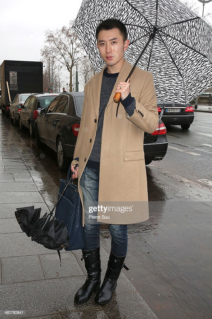 Jewels Designer Jamie wears a Lanvin Coat,Lanvin shoes on day 1 of Paris Fashion Week:Menswear Fall/Winter 2014-2015 on January 15, 2014 in Paris, France.