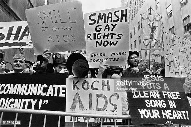 Jewish and Christian religious protestors opposite St Patrick's Cathedral during a Gay Pride march in Manhattan New York City June 1985 One placard...