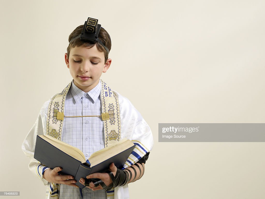 Jewish boy reading from siddur : Stock Photo