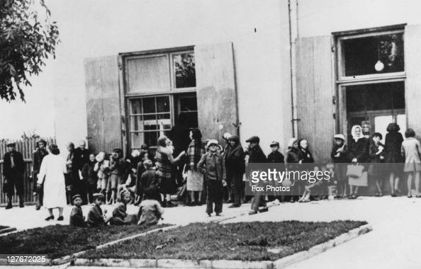 Jewish children queuing for food rations in the Warsaw Ghetto during the Nazi occupation of Poland March 1941