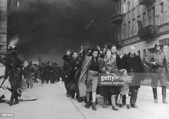 Jewish civilians are forced to march by SS soldiers in this 1943 photo during the destruction of the Warsaw Ghetto in Poland