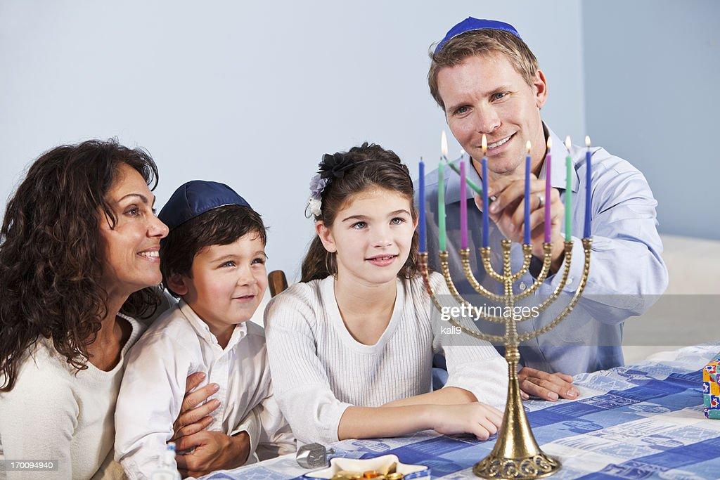 jewish family celebrating hanukkah stock photo getty images