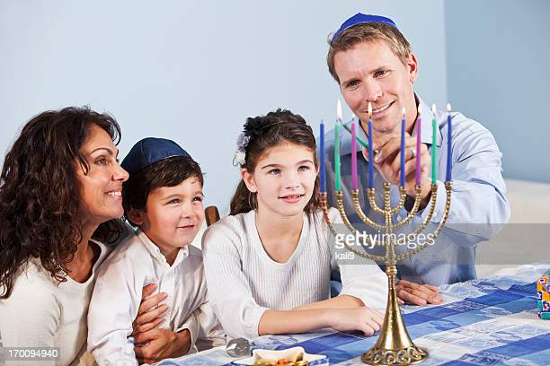 Jewish family celebrating Hanukkah