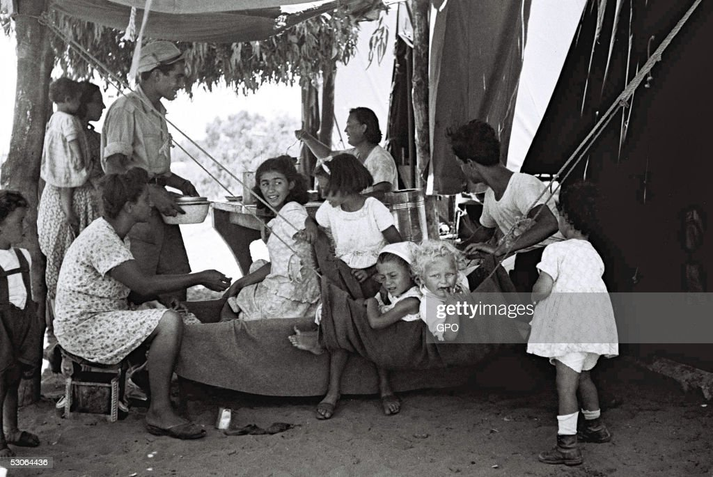 A Jewish family outside their tent at the new immigrants' camp December1, 1949 at Beit Lid in the newly-established State of Israel.