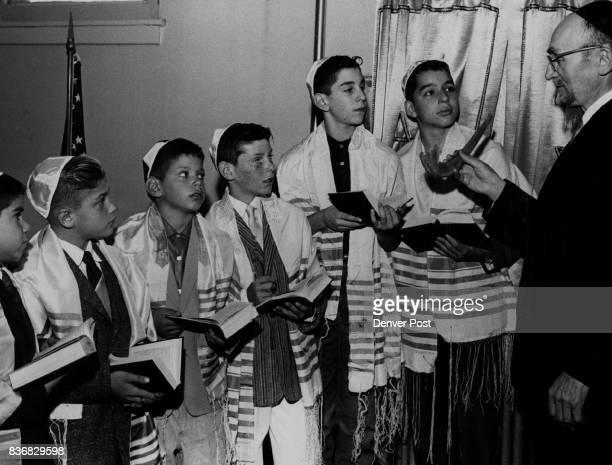 Jewish Holidays Boys Learn Significance of the Shofar Rabbi Chaim Davidovich explains significance of Shofar or ram's horn in Jewish New Year...