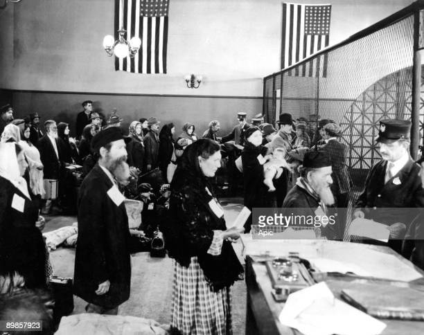 Jewish immigrants arriving at immigration office in Ellis Island in New York c 1910