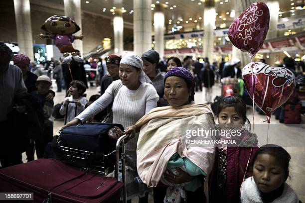 Jewish immigrants of the Bnei Menashe tribe of the Jewish community in Manipur northeast India wait to be reunited with family members as they arrive...
