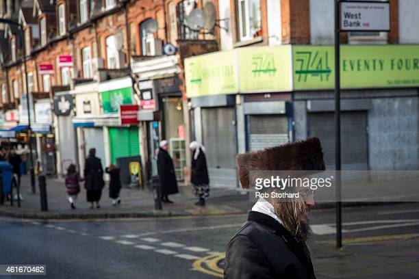 Jewish man crosses the street in the Stamford Hill area on January 17 2015 in London England Police have announced they will increase patrols in...