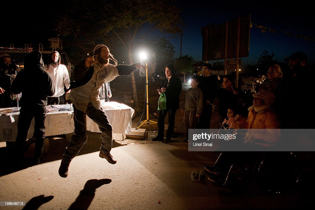 A Jewish man dances at the grave of Rabbi Yisrael Abuhatzera, known as the sage Baba Sali, on January 15, 2013 in the southern Israeli town of Netivot, Israel. Thousands of Jews, mainly of Moroccan origin, gathered to pray and hold festivities at the tomb of the respected rabbi who was known as a miracle maker by religious Jews.