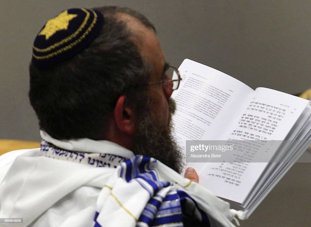 A Jewish man holds a songbook during a Jewish mass at the fourth day of the 2nd Ecumenical Church Day (2. Oekumenischer Kirchentag) on May 15, 2010 in Munich, Germany. Thousands will travel to the southern German city to take part in the Church Day events been held from May 12 to May 16, 2010.