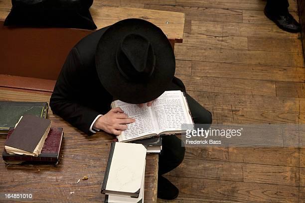 Jewish man reading religious text