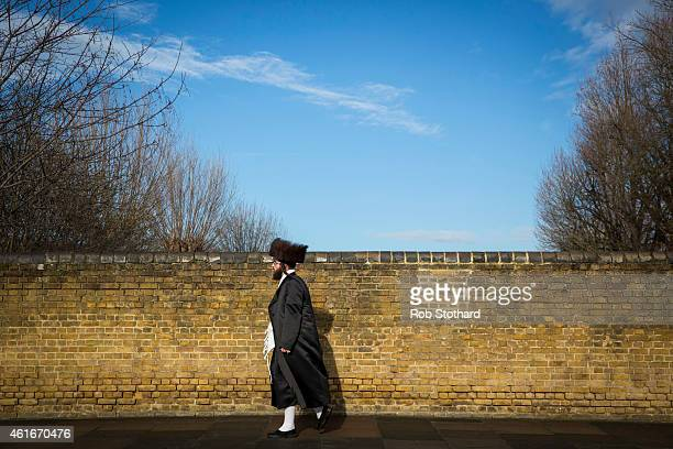 Jewish man walks across a bridge in the Stamford Hill area on January 17 2015 in London England Police have announced they will increase patrols in...