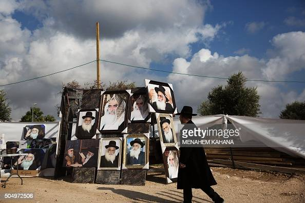 A Jewish man walks past a stall selling portraits of rabbis at the tomb of Rabbi Israel Abuhaeira known as the Baba Sali during the annual pilgrimage...