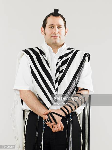 Jewish man wearing tallit and teffillin for prayers