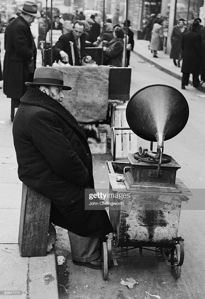 A Jewish man with a gramophone on wheels at a street market in Whitechapel in London's East End 12th April 1952 Original Publication Picture Post...