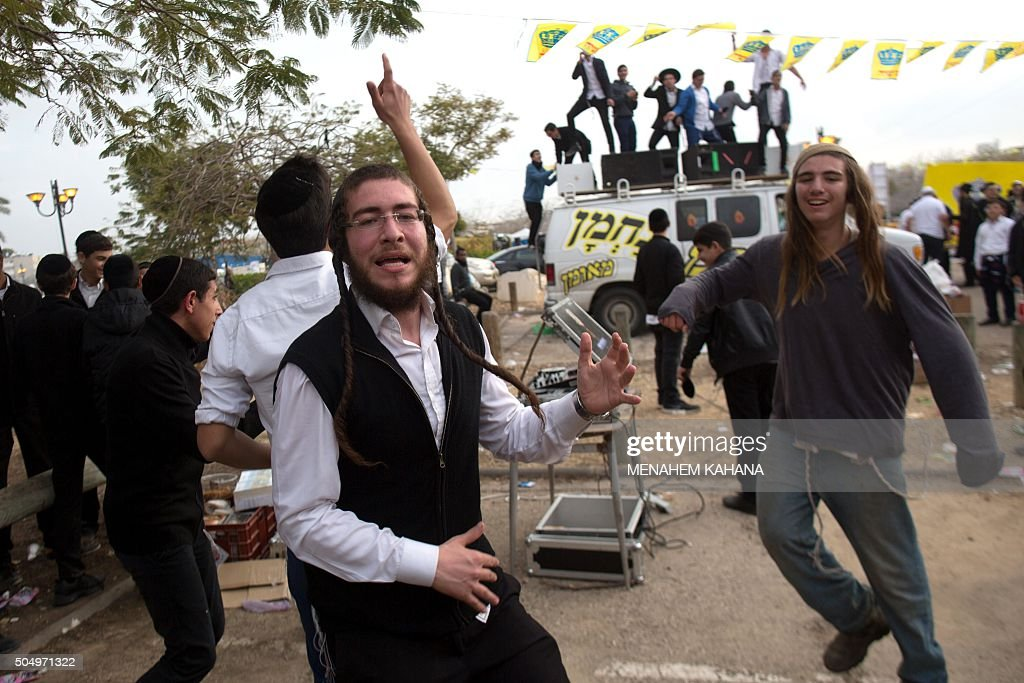 Jewish men dance at the tomb of Rabbi Israel Abuhaeira known as the Baba Sali during the annual pilgrimage to his grave in the southern Israeli town...
