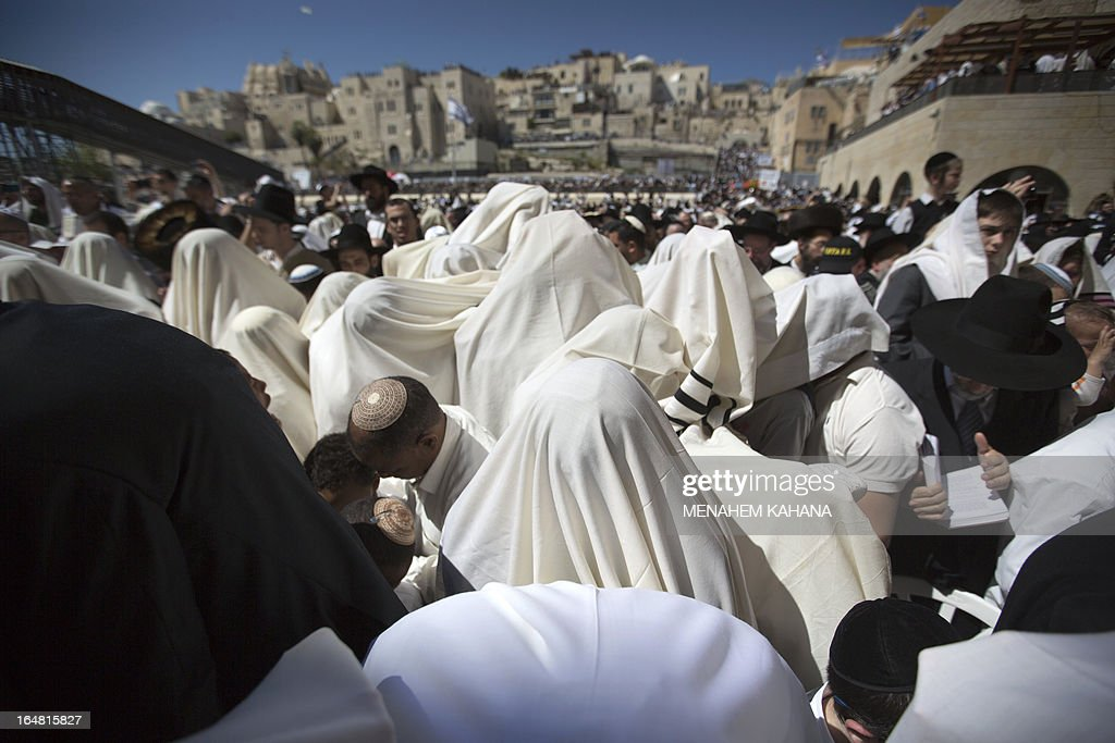 Jewish men draped in prayer shawls perform the Cohanim prayer (priest's blessing) during the Pesach (Passover) holiday at the Western Wall in the Old City of Jerusalem on March 28, 2013. Thousands of Jews make the pilgrimage to Jerusalem during the eight-day Pesach holiday, which commemorates the Israelites' exodus from slavery in Egypt some 3,500 years ago and their plight by refraining from eating leavened food products.