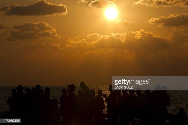 Jewish men pray along the beach in the coastal city of Ashdod during the ritual of Tashlich on September 29 2011 Jews traditionally walk to the...