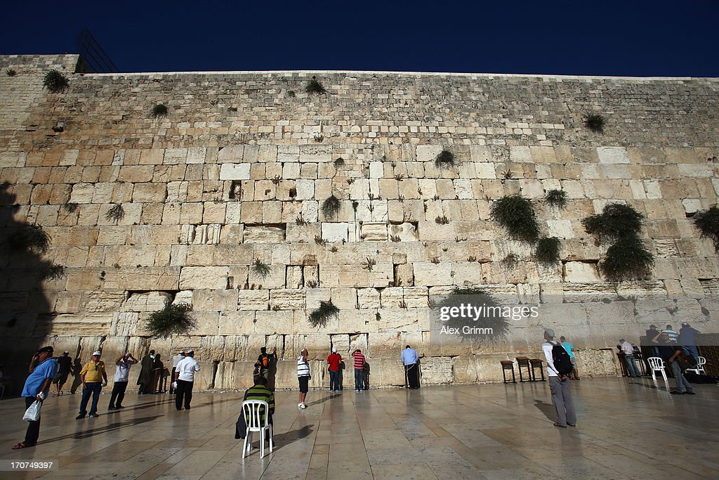 Jewish men pray at the Western Wall on June 16, 2013 in Jerusalem, Israel.