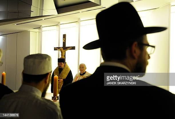 Jewish Muslim and Christian clergymen participate in the blessing of an ecumenical chapel at Poland's new national stadium in Warsaw on May 10 2012...