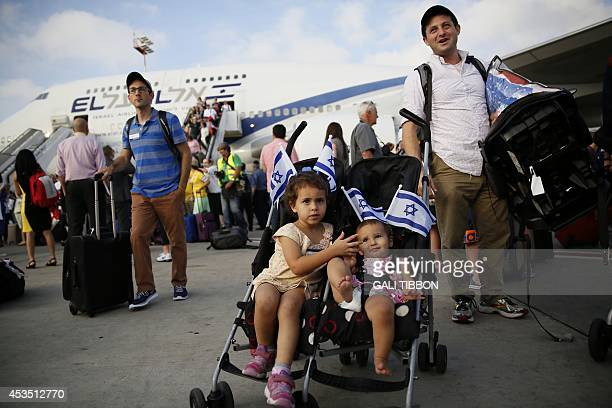 Jewish new immigrants from North America who are making Aliyah carry their luggage upon their arrival at Ben Gurion International airport on August...