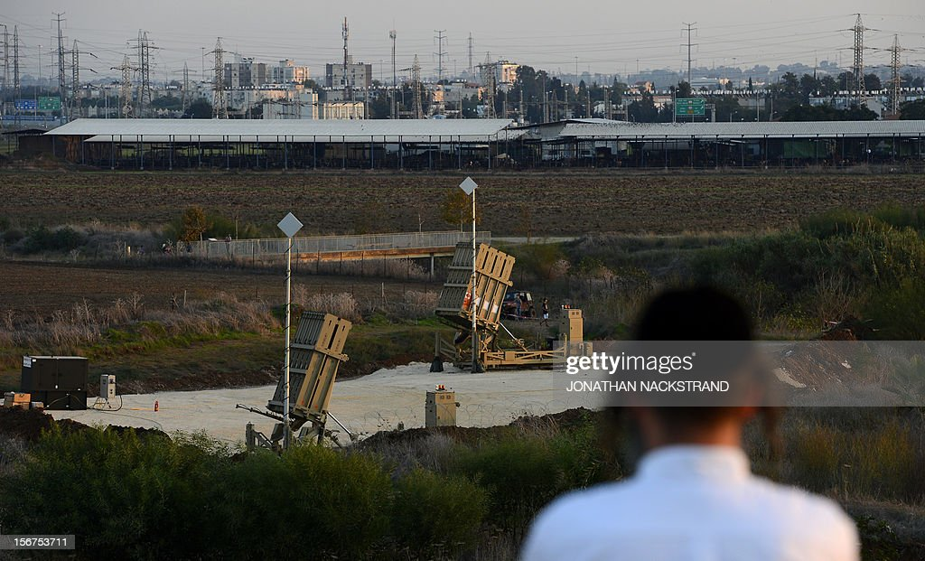 A Jewish orthodox man stands on a hill watching over Israeli military's Iron Dome defence missile system, designed to intercept and destroy incoming short-range rockets and artillery shells, in Gush Dan, the Tel Aviv metropolitan area, on November 20, 2012. Israeli Prime Minister Benjamin Netanyahu told Gaza's Hamas leaders to choose between peace and 'the sword' as a diplomatic push intensified to end a week of violence in and around the strip. AFP PHOTO / JONATHAN NACKSTRAND