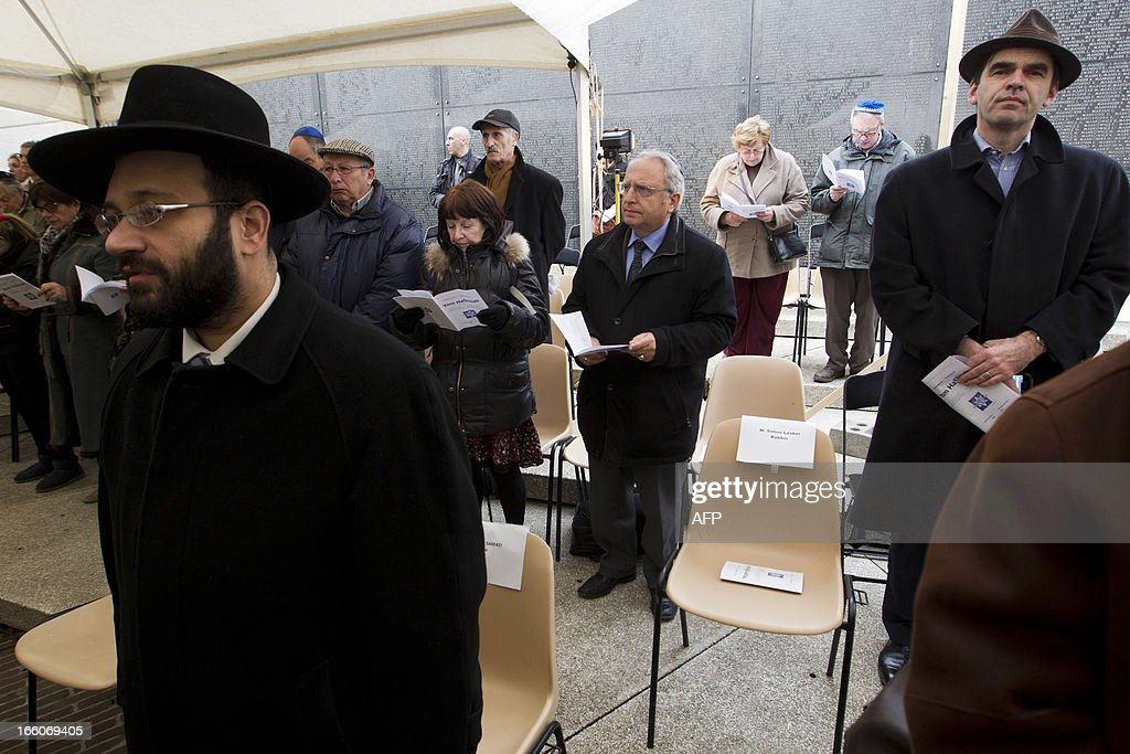 Jewish people attend a service on international 'Holocaust Remembrance Day', on April 8, 2013 at the National Memorial for the Jewish Martyrs in Brussels.