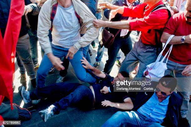 Jewish protesters fall on the ground after a clash with proPalestinian protesters during the march for the Liberation of Nazifascism organised by the...