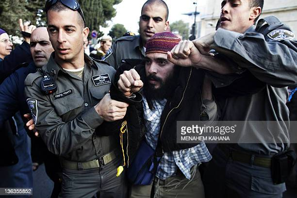 A Jewish rightwing protestor is arrested by Israeli border policemen during a demonstration in front of the Magistrates Court in Jerusalem on January...