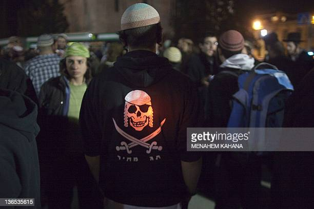"""A Jewish rightwing protestor wears a Shirt written on it in Hebrew is the slogan """"price tag"""" and a drawing of a skull during a demonstration of some..."""