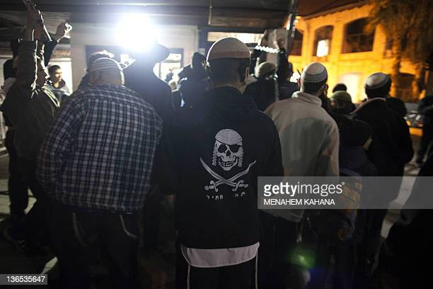 """A Jewish rightwing protestor wears a Shirt written on it in Hebrew """"price tag"""" and a drawing of a skull during a demonstration of some dozens in..."""