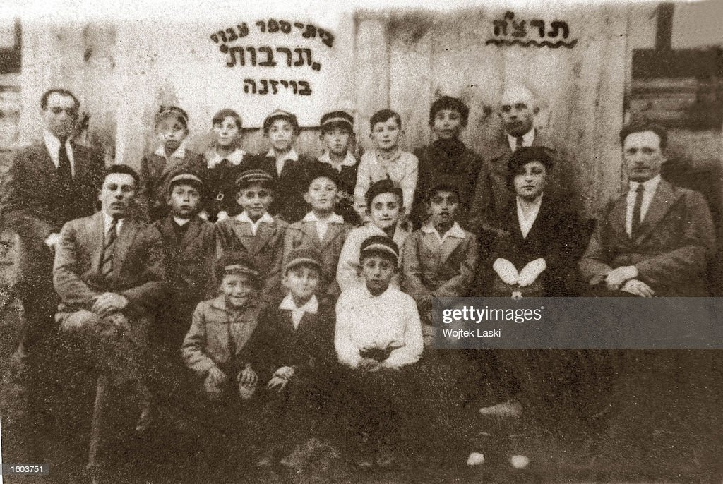 Jewish school children pose for a portrait in the 1930s in Wizna, near Jedwabne, Poland. New research revealed that members of the Polish community killed their Jewish neighbors July 10, 1941 during World War ll despite previous claims that Nazi Germans were entirely responsible. Polish President Aleksander Kwasniewski apologized for the massacre of hundreds of Jews by their neighbors July 10, 2001 during ceremonies marking the 60th anniversary of the murders. An exhibit documenting the killings is on display July 20.