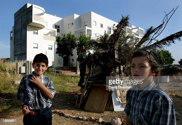 Jewish settler boys build a bonfire outside their apartment complex May 14 2003 in the West Bank Jewish settlement of Immanuel Israeli Prime Minister...