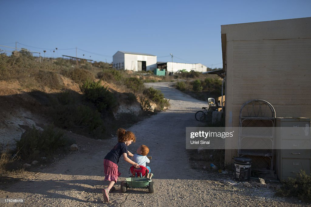 Jewish Settler children play outside their home on July 22, 2013 at the Jewish Settlement outpost of Havat Gilad in the West Bank. U.S. Secretary of State John Kerry announcedin a press conference in Amman last week that direct Israeli-Palestinian peace negotiations were to begin this week in Washington.