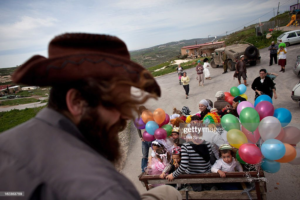 Jewish settler children wear costumes ahead of the Jewish festival of Purim February 22, 2013 at the settlement outpost of Havat Gilad, West Bank. The carnival-like Purim holiday is celebrated with parades and costume parties to commemorate the deliverance of the Jewish people from a plot to exterminate them in the ancient Persian empire 2,500 years ago, as described in the Book of Esther.