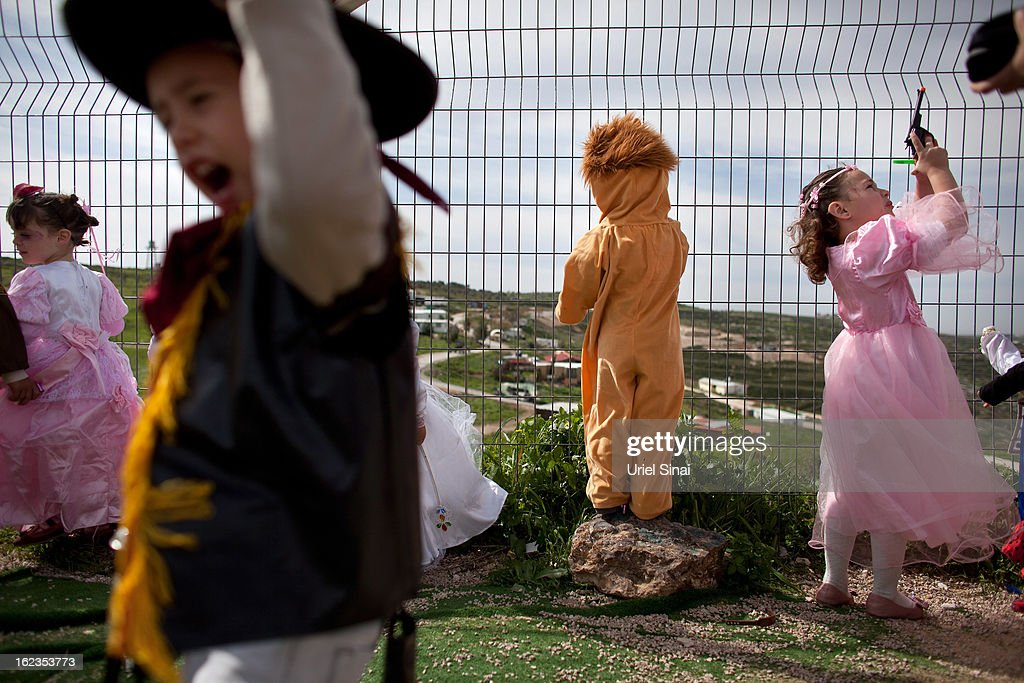 Jewish settler childrenÊwear costumes ahead of the Jewish festival of Purim February 22, 2013 at the settlement outpost of Havat Gilad, West Bank. The carnival-like Purim holiday is celebrated with parades and costume parties to commemorate the deliverance of the Jewish people from a plot to exterminate them in the ancient Persian empire 2,500 years ago, as described in the Book of Esther.
