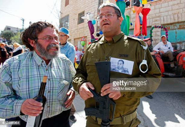 A Jewish settler dressed in military fatigues wears a portrait of Elor Azaria an Israeli soldier who shot dead a wounded Palestinian assailant in...