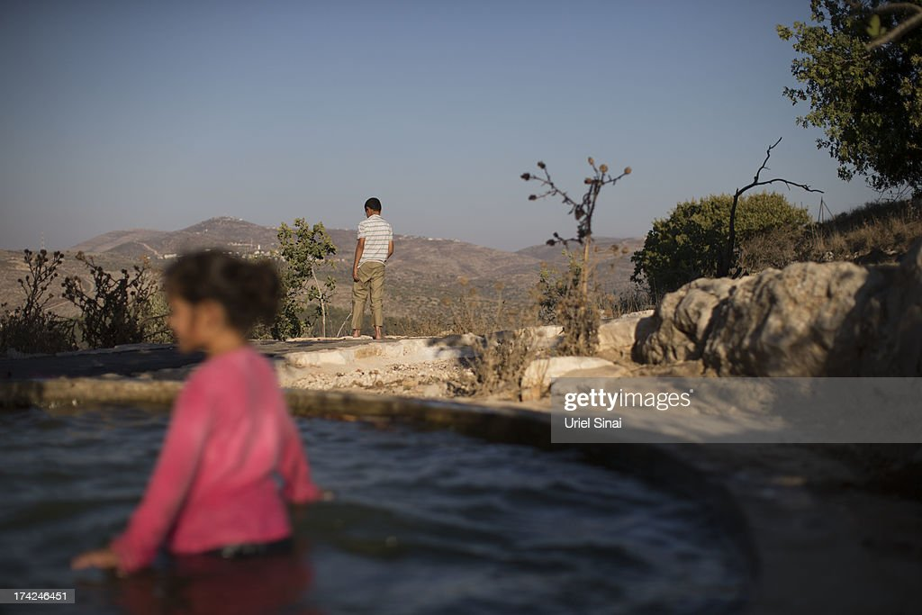 A Jewish settler girl swims in a pool on July 22, 2013 near the Jewish outpost Settlement of Har Bracha, West Bank. U.S. Secretary of State John Kerry announcedin a press conference in Amman last week that direct Israeli-Palestinian peace negotiations were to begin this week in Washington.