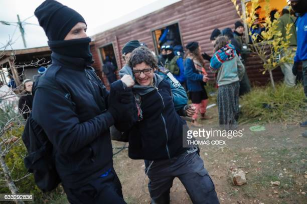 Jewish settler resists being taken away by Israeli security forces as they evict hardline residents from the wildcat Amona outpost northeast of...