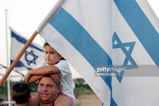 Jewish Settlers attend a farewell ceremony in the Nisanit Settlement during the second day of the disengagement on August 16 2005 in Gaza Strip Gaza...
