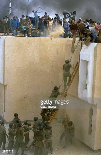 Jewish settlers clash with Israeli soldiers as they resist forced evacuation April 22 1982 from their Sinai Desert settlement of Yamit as part of...