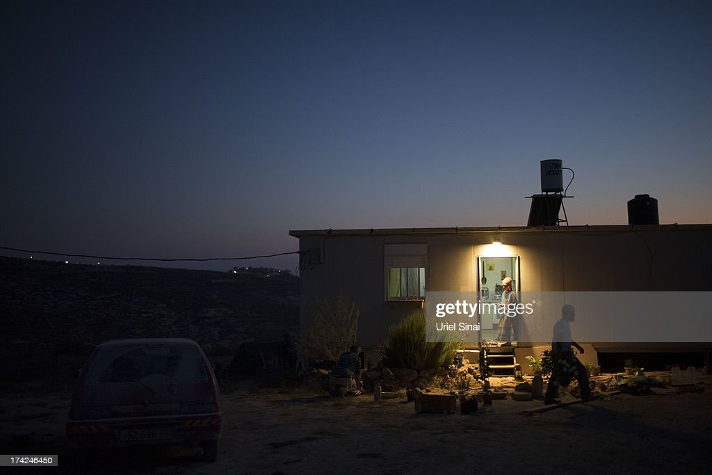 Jewish settlers outside their home on July 22, 2013 at the Jewish Settlement outpost of Havat Gilad in the West Bank. U.S. Secretary of State John Kerry announcedin a press conference in Amman last week that direct Israeli-Palestinian peace negotiations were to begin this week in Washington.