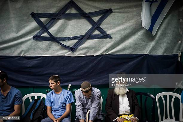Jewish settlers seen praying at the site of one of the stabbing attacks in the Muslim Quarter of the old city on October 12 2015 in Jerusalem Israel...
