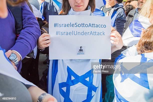 Jewish shows placard during a protest against the media and the attacks on Israelis