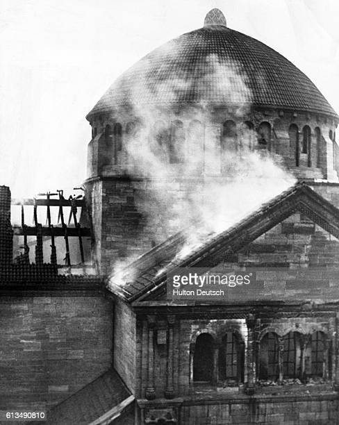 A Jewish synagogue burns after being set on fire by German mobs on Kristallnacht The mobs murdered Jewish people and destroyed their property in...