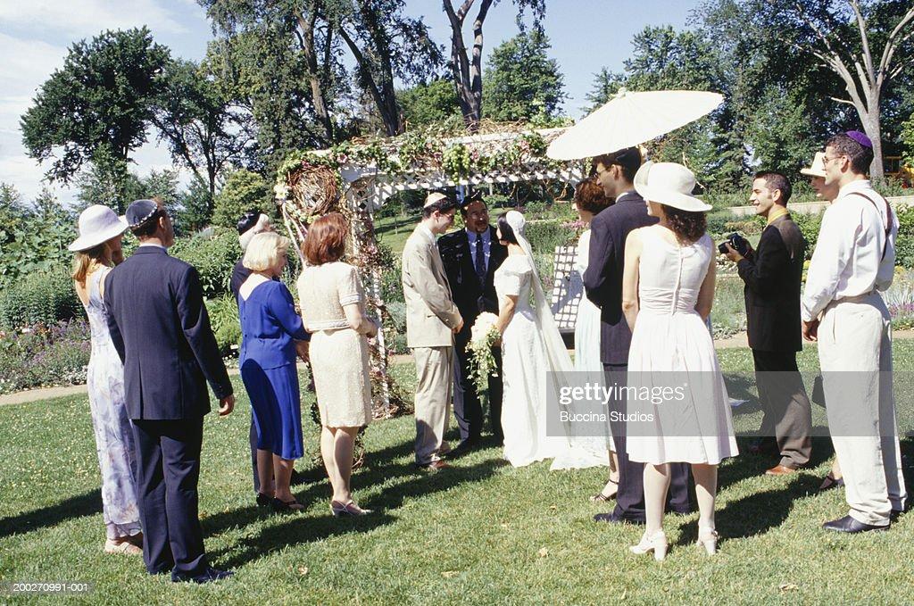 Jewish Wedding Ceremony In Garden Stock Photo