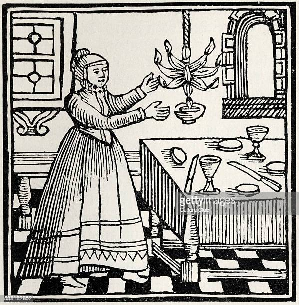 Jewish woman lighting the Sabbath lights Drawing from 1695 Amsterdam Passover Haggadah