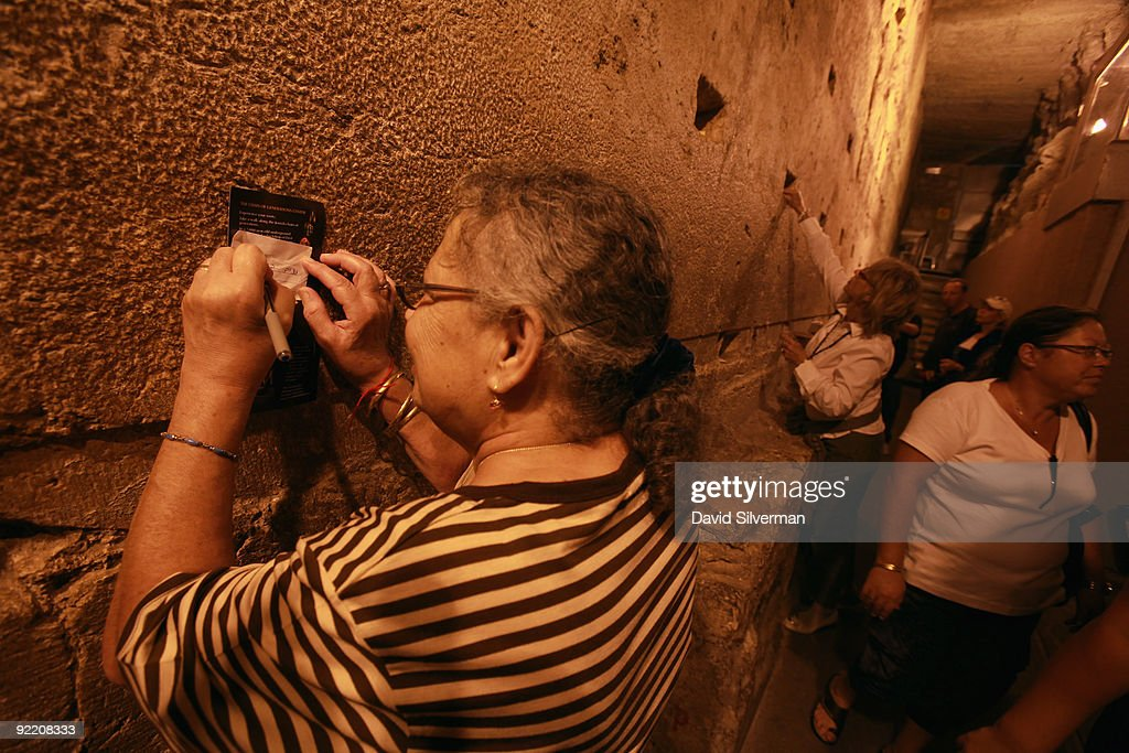 Jewish women leave notes to God in the Western Wall tunnels, on October 22, 2009 in Jerusalem's Old City. The Israeli Government Press Office organized a foreign press tour of the excavations which run alongside the outside of the Western Wall of the compound to categorically deny claims that the Israeli Antiquities Authority is conducting digs underneath al-Aqsa mosque. The Temple Mount, which was the site of the 1st and 2nd Jewish Temples, is known to Muslims as el-Harem al-Sharif and is today the site of both the golden Dome of the Rock and al-Aqsa mosque, Islam's third holiest shrine.