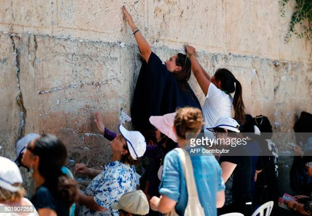 Jewish women pray at the women's section of the Western Wall the most holy site where Jews can pray in Jerusalem's Old City on June 27 2017 Israel's...